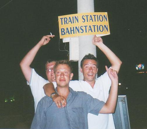 danny enthusiastically points to bahnstation sign